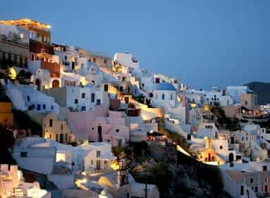 Little white buildings on the hill in Santorini, Greece